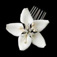 Beautiful Porcelain Orchid Floral Comb with Swarovski crystals and freshwater pearls. Both flower and freshwater pearls are a creamy off white. Approximately 2.75 inches in width. The perfect accent for a destination, beach or tropical wedding.
