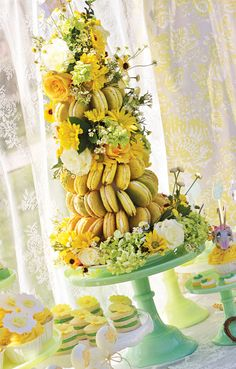 gorgeous macaron tower! Sound of Music Inspired Bloom & Grow Birthday Party styled by Million Dollar $miles