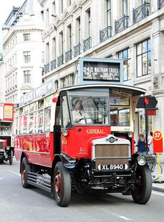 """Red Double-decker is one of the most prominent London icons. We just so happened to run into the """"Year of the Bus - The Regent Street Bus Cavalcade"""" while we were there. It took us on a trip down memory lane by showing us all the double-deckers London had to offer over the years."""