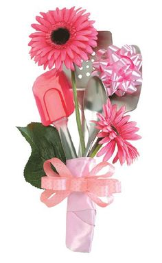 Centerpiece idea. The bottom looks like crap, but i like the idea of mixing some flowers with kitchen utensils