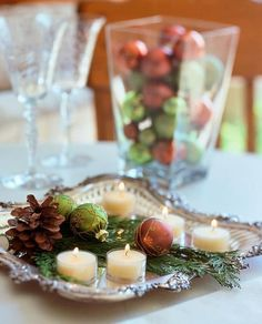 This one looks simple and inexpensive Christmas centerpiece ideas: ornaments on a tray