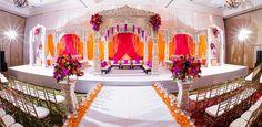 Vibrant coloured backdrop and lots of petals = fewer bouquets/arrangements
