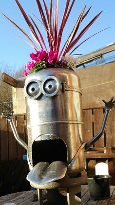Minion like planters made from recycled gas bottles great for the garden avalible in 3 sizes and all styles