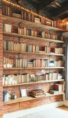 love the brick wall behind the books...  #easy #DIY #corner #bookshelves #livingroom