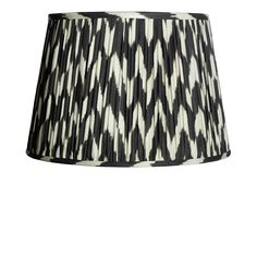 A gathered empire shade in a striking black and white zig-zag ikat pattern. Hand-made from soft natural linen with a warm cream fabric lining