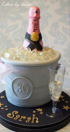 This is the second champagne bottle in an ice bucket I have done. Ice bucket is lemon sponge, lemon buttercream and lemon curd with the bottle made from RKT and chocolate.