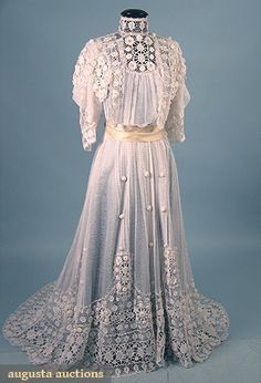 "IRISH CROCHET & NET DRESS, c. 1905 Unlined 1-piece, white cotton net w/ Irish crochet sleeves, bodice & deep hem flounce, exceptionally padded lace florals, B 38"", W 32"", front L 57"", back L 73"", excellent."