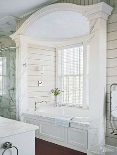 Casual elegant bath.  Love the arch  above the bath and of course the marble.