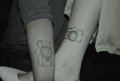 I want a camera tattoo...