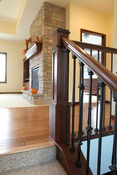 Stair Systems | Poplar staircase with wrought iron balusters | Bayer Built Woodworks