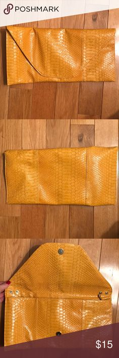 Yellow Snakeskin Clutch Super cute yellow faux snakeskin envelope clutch! Bags Clutches & Wristlets