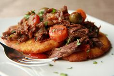 Ropa Vieja with Arepas: Ropa Vieja is a traditional Cuban dish, usually made with flank steak. It is cooked until very tender and it shreds, which is why it is called Ropa Vieja.  Ropa Vieja translate to ragged clothes or old clothes.