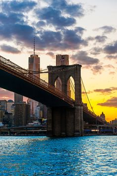 The Brooklyn bridge which connects Manhattan and Brooklyn at sunset, East River, New York, New York USA.