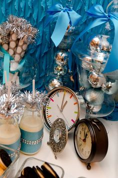 Get mini clocks for kid's part favors or for the scavenger hunt   New Year's Eve Display:  Love all the clocks !!