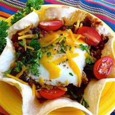 This Huevos Rancheros recipe, from Egg Farmers of Ontario, features local Ontario eggs topped with juicy tomatoes and fresh cilantro.