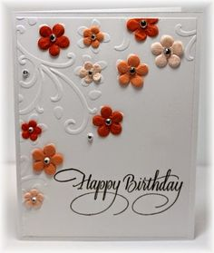 The card - this is a quick and super easy one.  I used an embossing folder with flowers on it, added a sentiment, some prima flowers and ...