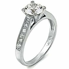 Classic Womens Sterling Silver Accented Solitaire Engagement Ring 1.55 carats (sizes 5 to 9) 1000 Jewels. $36.00. A stunning choice for an engagement ring. Designed to sit flush against low profile wedding bands.. Solid 925 Sterling Silver with protective Platinum White Rhodium finish. 100% lead and nickel free.. Ring weighs approx. 3.6 grams.. Available in US sizes 5 through 9!. Features a sparkling 1.25 carat diamond equivalent, Ideal Brilliant-cut Russian Ice on F...