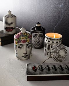 Fornasetti Scented Candle. I love the face one in color!!  Maybe when I win the lottery!!