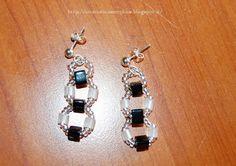 Tante piccole idee realizzate: Fantasia di forme: orecchini con perline nere, bianche e rocailles trasparenti.