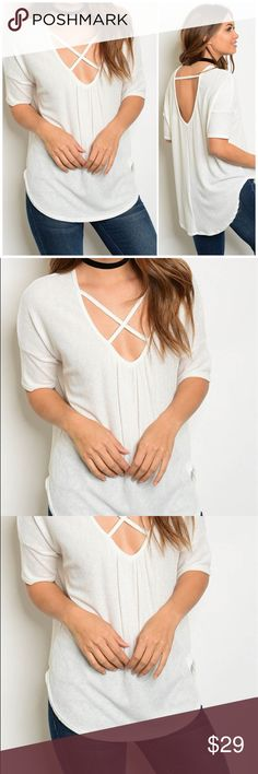 "🆕 White Criss Cross Top White Front Criss Cross Top. 72% polyester 23% Rayon 5% spandex. Measurements for small bust 40""/ length 26"" Bchic Tops"