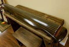 Concert Aged Chinese Fir Guqin - Fu Xi Style by Han Tiansheng. $850.00. This beautiful instrument is brand new hand made by reputed Yangzhou maker. It's a concert grade quality instrument in Fu Xi style. The material is made with aged Chinese Fir and traditional lacquer using deer horn powder. It's tuned in F key pentatonic scale. Tuning in order from the 1st string to 7th string is C D F G A C D. This is a great quality instrument.. Save 53% Off!