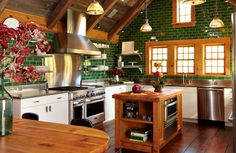 gorgeous kitchen refurbished with reclaimed woods from The Hudson Co., including douglas fir floors, hemlock beams, barn siding ceiling, and heart pine island.