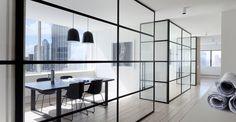 Black steel frames. Blonde timber floors. Clean. White