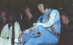 """Elvis sitting in Sherrill """"Shaun"""" Nielsen's chair.  Elvis asked Sherrill to take center stage and sing one of Elvis' favorite gospel songs """"Walk With Me"""" ... Elvis said """"I need my soul restored""""."""