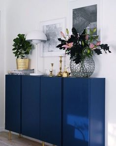 Glossy, bold blue paint on Ikea Ivar cabinets makes a big difference.