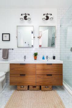 """""""My favorite splurge on the top floor was a heated bathroom floor—worth every penny in the winter"""", this renovator shared. What's on your splurge list? Floating Bathroom Vanities, Floating Vanity, Bathroom Storage, Ikea Bathroom Vanity, Condo Bathroom, Bathroom Marble, Bathroom Laundry, Wooden Bathroom, Remodel Bathroom"""
