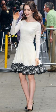 On Good Morning America, Lily Collins promoted her film Mortal Instruments: City of Bones in a pretty white pleated Valentino dress with a black lace hem. She accessorized with black-and-nude lace Jimmy Choo pumps and a diamond Jacob & Co. cocktail ring.