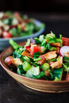 Fattoush Salad Recipe. Middle Eastern chopped salad w/ lots of fresh herbs and pita chips for croutons. Covered in a zesty lime vinaigrette! Delicious!