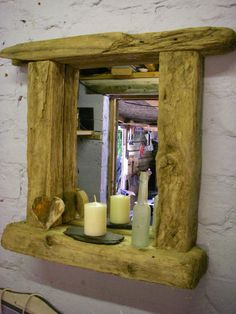 Natural driftwood Chunky mirror with shelf   Featuring chunky frame with shelf for candles etc   Fantastic weathered driftwood   The material used in this hand crafted product shows  signs of former life or use    Dimesions 68cm x 60 cm    £75.00