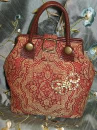 carpet bag with rhinestone butterfly pin.  cuteness!