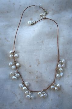 White freshwater pearls on leather by MonicaDesignsJewelry on Etsy, $48.00