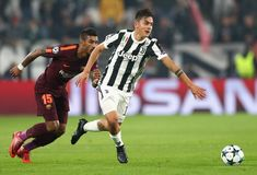 Paulo Dybala of Juventus and Lionel Messi of Barcelona battle for possession during the UEFA Champions League group D match between Juventus and FC Barcelona at Allianz Stadium on November 22, 2017 in Turin, Italy.