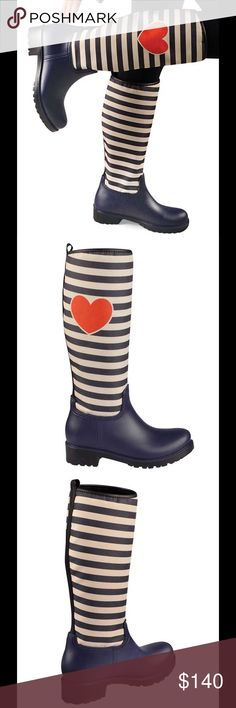"""🎉HP🎉NAVY STRIPED RAINBOOTS❤️ ❤️️NAVY STRIPED RAINBOOTS❤️Add color and personality to your feet while keeping them warm and dry in these playfully patterned rainboots!! Soft and cozy!The striped part of the boot is soft and flexible. Man-made lining &upper. Rubber sole. The length of the bottom of the boot measures about 10""""length, widest part of the boot(bottom) across is about 3 1/2"""". The heel is 2 1/2"""" across(bottom)The heel is 1 1/2"""" high. The boot is about 14 3/4""""tall🎉HP chosen by…"""