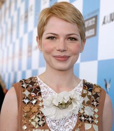 Use your fingers and a little hair wax to style your hair into a side-swept style like Michelle Williams's.