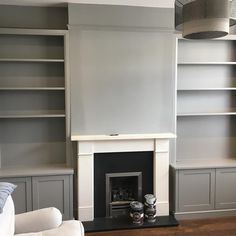 Farrow and Ball painted (Cornforth White). Farrow and Ball painted (Cornforth White). White Painted Fireplace, Paint Fireplace, Cornforth White Living Room, Alcove Cabinets, Farrow And Ball Paint, Fitted Wardrobes, Media Cabinet, New Living Room, White Paints