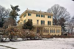 Southeast side of the mansion. It's been told that on a snowy day, the apparition of a young woman sometimes is seen inside the enclosed porch of that side of the mansion.