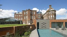 Hotel Du Vin is a luxury boutique hotel set in Exeter's former eye hospital. It boasts contemporary styled rooms, a spa with heated year-round outdoor pool and a restaurant. There is also a fitness centre, a bar and a library with over 750 books. Exeter England, Bristol City Centre, Exeter Cathedral, Outside Pool, Private Dining Room, Brick Building, Workout Rooms, Outdoor Pool, Swimming Pools