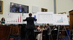 House Judiciary Committee staff put up charts and graphs during a hearing about the recent surge of unaccompanied Central American minors who have been crossing the US-Mexico border, in Washington, DC, June 25, 2014.