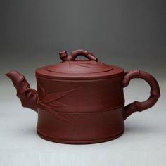 Chinese handmade yixing zisha purple clay antique yixing teapots by Ufingo, http://www.amazon.com/dp/B00CSDRCKI/ref=cm_sw_r_pi_dp_Qlhasb0G9ARD9.  I think the one I purchased at the estate sale is from the purple clay.  Also bamboo motif.