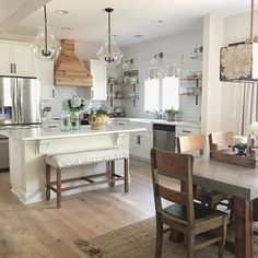 I can't even believe I'm almost done with my punch list for my kitchen. Only three projects remain... sewing a slipcover for my bench using that European grain sack, installing a few beams and trimming out my island with chunky x style legs. Tap the photo for sources.