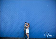 Jessica & Brett's Engagement Photography Session - Santa Monica Pier - Los Angeles, CA - boardwalk, ferris wheel, carnival, ride, games, beach, formal, dress, suit, couple, engaged, sunset, silhouette, blue wall, GilmoreStudios.com
