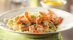 Shrimp scampi is an Italian-restaurant favorite, and it's so easy to make at home! With just a few ingredients, this shrimp scampi recipe is made right in a skillet. Serve these succulent shrimp over a bed of hot fettuccine or angel hair pasta and sprinkl Shrimp Dishes, Shrimp Recipes, Pasta Dishes, Fish Recipes, Pasta Recipes, Cooking Recipes, Healthy Recipes, Recipies, Burrito Recipes