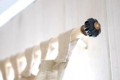 inexpensive curtain rod....long dowel and drawer pulls!