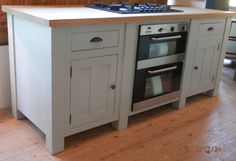This freestanding base unit has an electric oven and hob built in. http://www.john-willies.com/kitchens/freestanding_baseunits.php