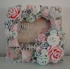 Prima Tea Thyme Altered Canvas with handmade roses. I love the way everything is coated white on the edges.