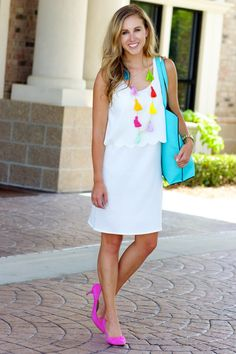 Multi layered dress and a long tassel necklace